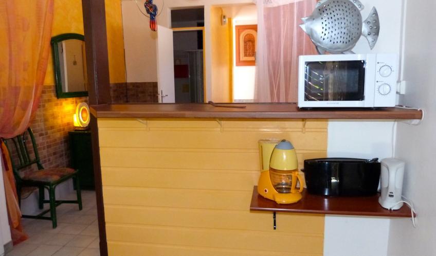 Un bar, sépare votre chambre de la cuisine.